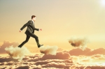 Businessman is walking on clouds in the sky concept